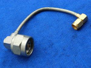 Cable SM141CU N maschio90°/SMA maschio cm. 10